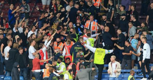 Burnley and Arsenal supporters clash with stewards forced to intervene
