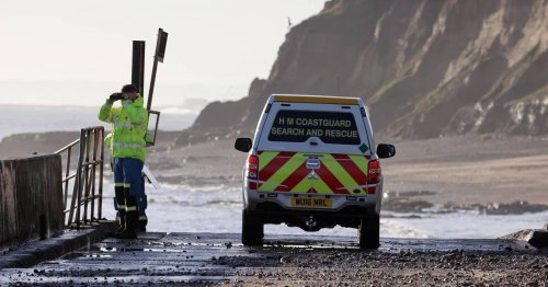 Woman swept out to sea in 40mph gales as flood warnings issued across UK