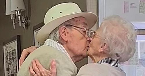 Heartwarming moment elderly couple kiss as they are reunited after months apart