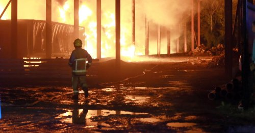 Massive fire tears through 30 lorries as residents warned to keep windows closed