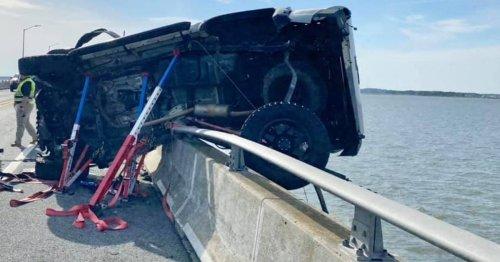 Hero saves girl, 2, thrown into bay as crash left car teetering on bridge edge