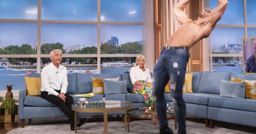 Holly Willoughby blushes on This Morning as Dreamboys hunk show off his moves