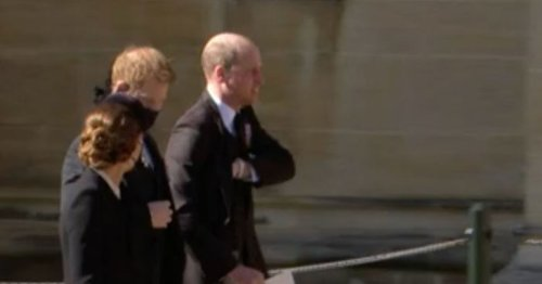 Prince Harry and William seen talking together as they leave chapel
