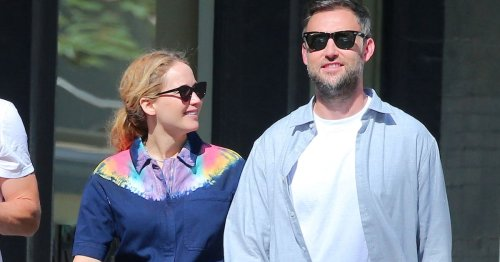 Pregnant Jennifer Lawrence debuts growing baby bump on stroll with husband