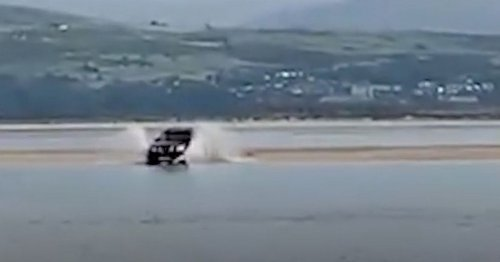 Moment 4x4 driver gets stuck on sandbank after ignoring warnings from wardens