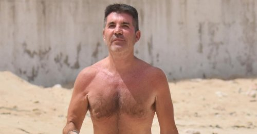 Simon Cowell unveils back op scar in uncharacteristic low-riding shorts