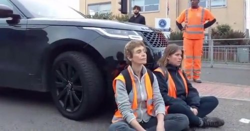 Moment angry Range Rover motorist drives into Insulate Britain protesters