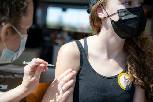 If you're fully vaccinated against COVID-19, how safe are you really without a mask?