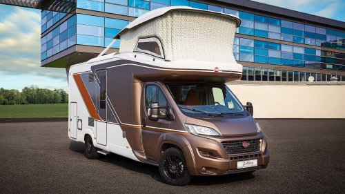 This RV Has A Hideaway Second Floor With Bedroom And Workspace