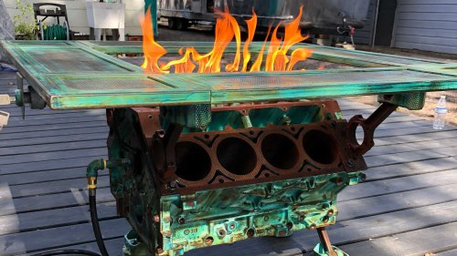 This fire-breathing engine table with working accelerator pedal is so metal