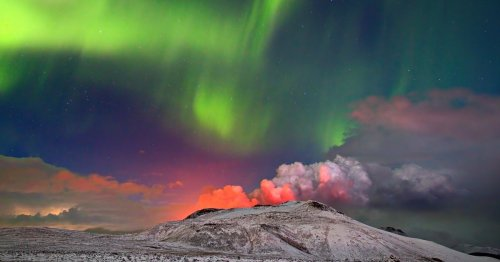 Photographer Captures Viral Shot of the Northern Lights Behind an Erupting Volcano