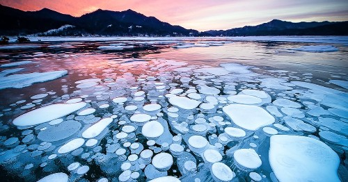 Ethereal Ice Bubbles Emerge at the Surface of a Mystical Lake in Hokkaido, Japan