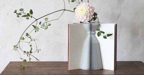 Ordinary Books Open to Reveal Elegant Paper Vases Tucked Between the Covers