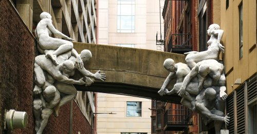 Incredible Installation Shows Intertwined Figures Trying to Hold Up a Bridge in Philadelphia