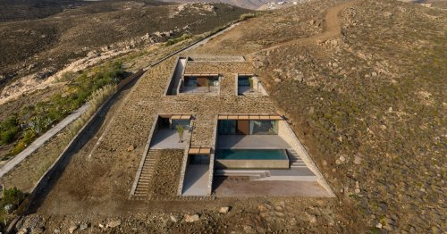 This Unassuming House Is Concealed in the Side of a Greek Island Cove