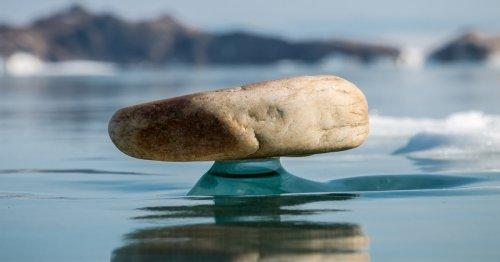 Rare 'Baikal Zen' Phenomenon Has Rocks Balancing on Pedestals of Ice on Lake Baikal