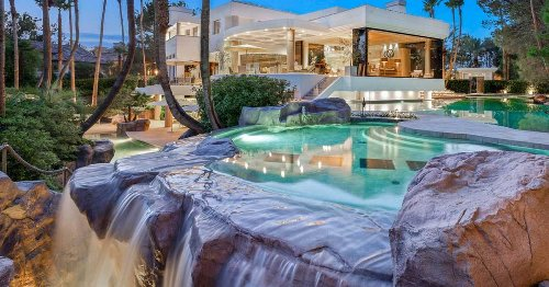 This Las Vegas Home For Sale Has Three Pools & One Has A Magical Waterfall