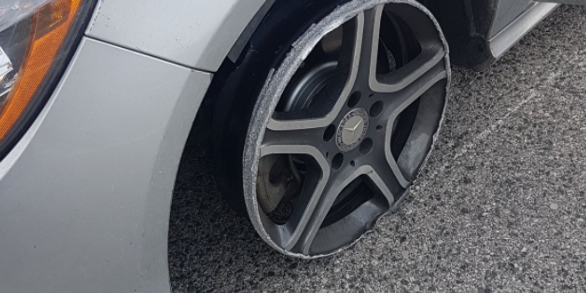 Drunk Driver Caught Flying Down The 401 With A Tire Missing (PHOTOS)