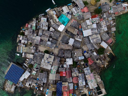 See photos of the most crowded island on earth