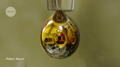 Water transformed into shiny, golden metal