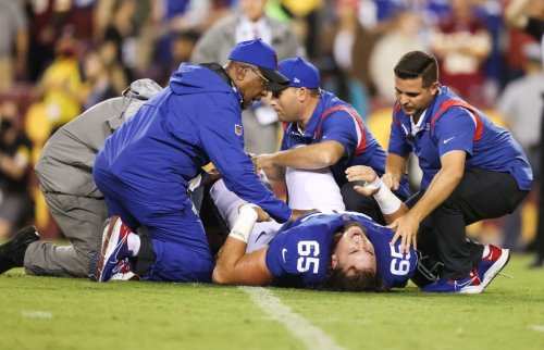 Nick Gates carted off with gruesome lower leg fracture