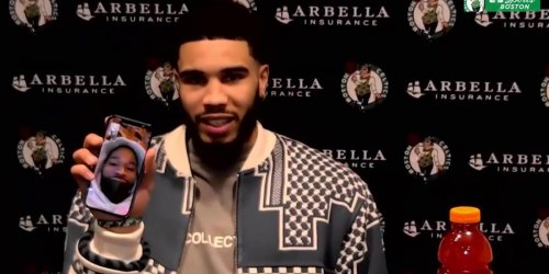 Tatum sits for postgame presser with Javonte on the phone
