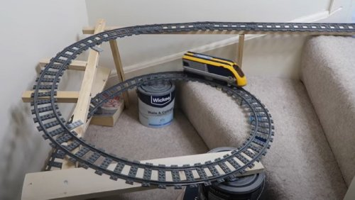 Man Builds Epic LEGO Train Set Spanning His Entire Home - Nerdist