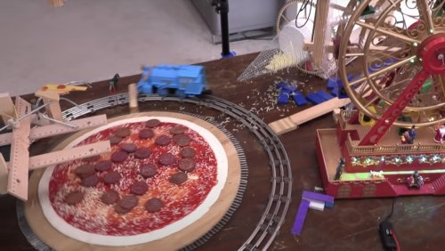 Pizza-Making Contraption Uses a Toy Train and Ferris Wheel - Nerdist