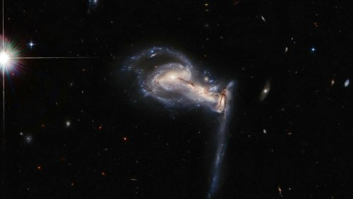 NASA Releases Mesmerizing Image of Three Galaxies 'Fighting' - Nerdist