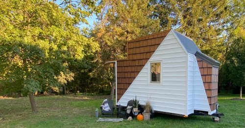 Micro house on wheels boasts skylight shower and glass roof loft bedroom