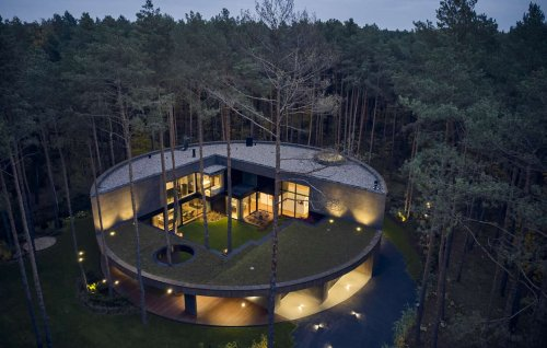Unusual circular home is nestled within a Polish forest