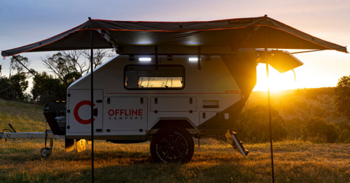 Brawny Domino dual-mode trailer swallows campers with yawning jaws