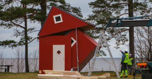 Folding tiny house tucks away for easy transportation