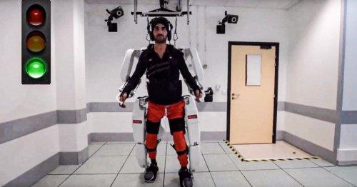 Brain-controlled exoskeleton allows quadriplegic man to walk and manipulate items