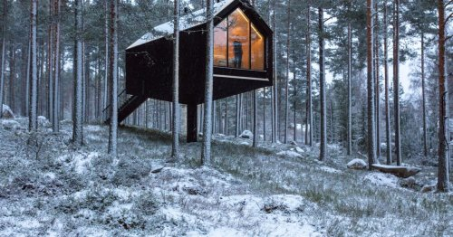 Tiny cabin balances on a single pillar in Finnish highlands