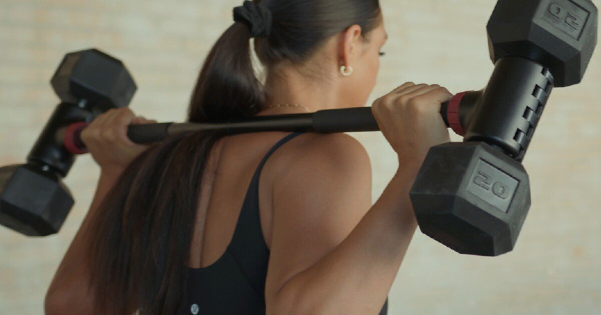 Hybrid weight system converts dumbbells into barbells