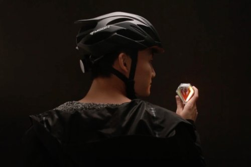 Bicycle turn-indicator tail light is activated by shoulder-checking