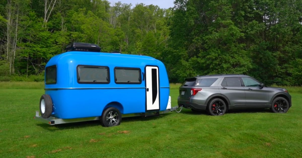 Lustrous vacuum-infused camping trailer blends timeless and modern