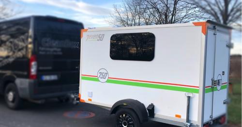 Unassuming mini-camper packs tiny home living in a box trailer