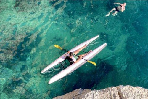 Inflatable Super Kayak catamaran packs into a bag for transport