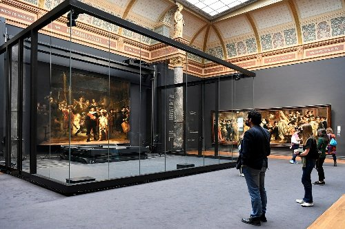 Rembrandt's 'Night Watch' Back on Display at Amsterdam Museum With Missing Parts Restored Using AI