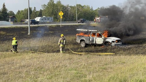 Vehicle fire causes grass fire along the south Perimeter Highway
