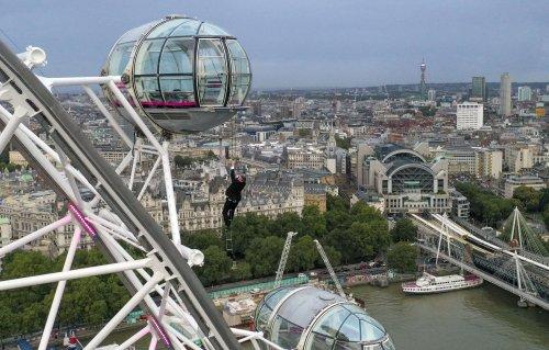 Bond lookalike performs daring stunt on London Eye ahead of film premiere