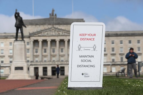 NI ministers agree relaxations on international travel and social distancing