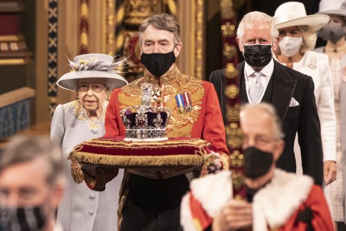 A very different State Opening of Parliament for widowed Queen: no formal robes, no crown and no beloved Philip at her side