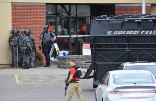 Four hostages released as stand-off continues at Minnesota bank