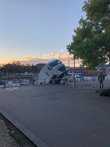 Lorry partially submerged in harbour plunge