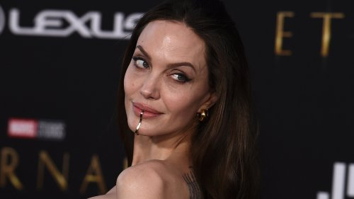 Angelina Jolie wears opinion-dividing 'chin cuff' on the red carpet – would you try the celebrity face bling trend?