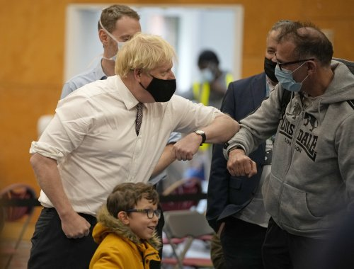 PM refuses to commit to wearing face mask despite Javid plea