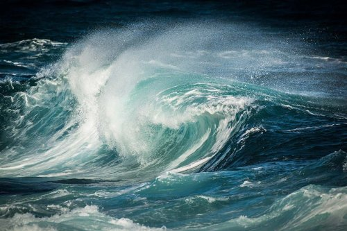 What causes waves in the ocean?